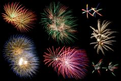 Fireworks. Multiple fireworks collage in different sizes and colors on a black background royalty free stock images