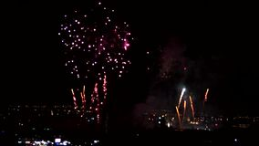Fireworks. Multiple fireworks explosions over a city in mexico in the celebration of the independence day, exploding lights in different colors lighting the city stock footage