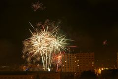 Fireworks Near to Estate Housing. New Year's Eve fireworks near to estate housing in the night Royalty Free Stock Image
