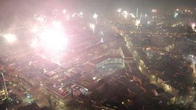 Fireworks on new years eve. As seen from a 101 meters high building in the center of Enschede in the Netherlands stock footage