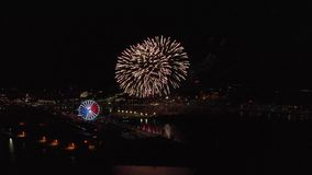 Fireworks at night against the background of the city and river panorama stock video footage