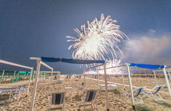 Fireworks at night on a beautiful beach Royalty Free Stock Images