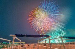 Fireworks at night on a beautiful beach Stock Image