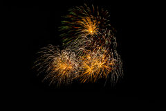 Fireworks in the night.New Year celebration fireworks,Colorful fireworks over dark sky, displayed during a celebration event. Fireworks in the night.Fireworks in Stock Photo