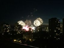 Fireworks at night over buildings stock photos