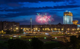 Fireworks at night. Fireworks over the night square Royalty Free Stock Image