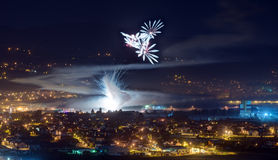 Fireworks in night. Fireworks over  town Samobor in Croatia at night. Smoke, lights, houses Stock Images