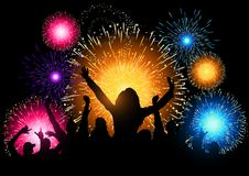 Fireworks Night Party. A crowd of people cheering at a fireworks display Stock Image