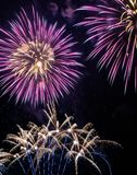 Fireworks in the night. Purple fireworks on the night of new year`s day Stock Photo