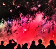 Fireworks. Night scene of crowd watching spectacular fireworks Stock Images