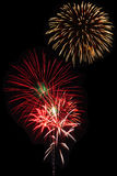 Fireworks on night sky background.  Stock Images