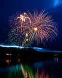 Fireworks In The Night Sky. Fireworks display over a lake Stock Image