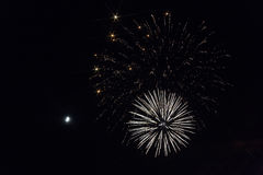 Fireworks in the night sky. A month in the dark sky Royalty Free Stock Photos