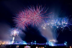 Fireworks in the night sky over a bridge Royalty Free Stock Images
