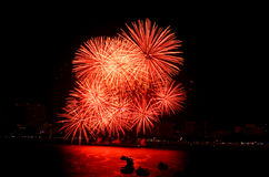 Fireworks in the night sky. Reflected in water Royalty Free Stock Image