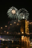 Fireworks over the bridge. Fireworks in Cincinnati, part of the old bridge visible Royalty Free Stock Images