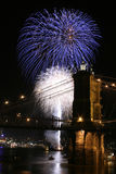 Fireworks over the bridge. Fireworks in Cincinnati, part of the old bridge visible Stock Photo