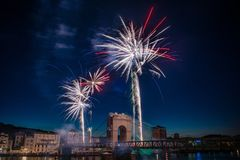 Fireworks during celebrations of French national holiday. Fireworks over the bridge during celebrations of French national holiday, July 14, in Vienne France royalty free stock photos
