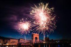 Fireworks during celebrations of French national holiday. Fireworks over the bridge during celebrations of French national holiday, July 14, in Vienne France stock photos