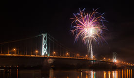 Fireworks over a bridge Stock Photo