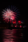 Fireworks over bridge. Fireworks over a bridge illuminate the night Royalty Free Stock Photos
