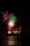 Fireworks over bridge. Fireworks over a bridge illuminate the night Royalty Free Stock Image