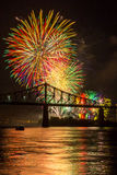 Fireworks over bridge. Fireworks over a bridge illuminate the night Stock Photo