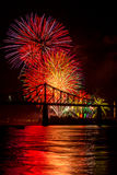 Fireworks over bridge. Fireworks over a bridge illuminate the night Stock Image