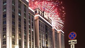 Fireworks over the Building of The State Duma of the Federal Assembly of Russian Federation, Moscow, Russia with zoom.  stock footage