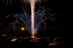 Fireworks Over Cars. A unique shot of fireworks over the audience of cars Royalty Free Stock Image