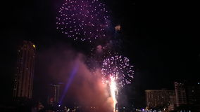 Fireworks over Chao Phraya River. And various luxury hotels and condominiums along the Chao Phraya waterfront at dusk stock video