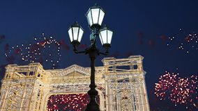 Fireworks over the Christmas illumination light gates/arches installations of Journey to Christmas in Moscow, Russia.  stock footage