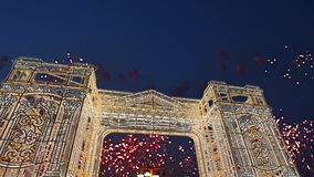 Fireworks over the Christmas illumination light gates/arches installations of Journey to Christmas in Moscow, Russia.  stock video footage