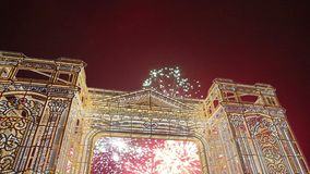 Fireworks over the Christmas illumination light gates/arches installations of Journey to Christmas in Moscow, Russia with zoom.  stock video