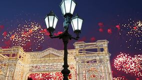 Fireworks over the Christmas illumination light gates/arches installations of Journey to Christmas in Moscow, Russia with zoom.  stock footage