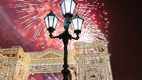 Fireworks over the Christmas illumination light gates/arches installations of Journey to Christmas in Moscow, Russia with zoom.  stock video footage