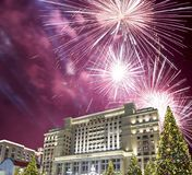 Fireworks over the Christmas and New Year holidays illumination and Four Seasons Hotel Moscow at night. Russia, Stock Photos