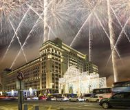 Fireworks over the Christmas and New Year holidays illumination and Four Seasons Hotel Moscow at night. Russia, Royalty Free Stock Photos