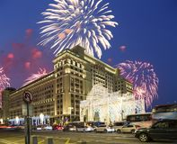 Fireworks over the Christmas and New Year holidays illumination and Four Seasons Hotel Moscow at night. Russia, Stock Images