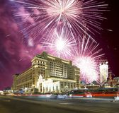 Fireworks over the Christmas and New Year holidays illumination and Four Seasons Hotel at night. Moscow. Russia. Royalty Free Stock Photos