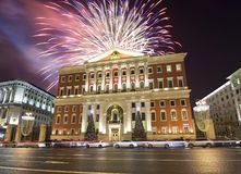 Fireworks over the Christmas and New Year holidays illumination in Moscow city center and Government building on Tverskaya street stock photos