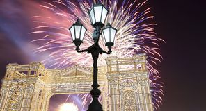 Fireworks over the Christmas and New Year holidays illumination in Moscow city center at night, Russia Stock Photo