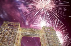 Fireworks over the Christmas and New Year holidays illumination in Moscow city center at night, Russia Stock Photography