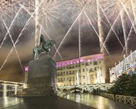 Fireworks over the Christmas and New Year holidays illumination. Yury Dolgoruky  Monument, Russia. Fireworks over the Christmas and New Year holidays Stock Image