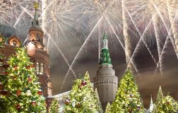 Fireworks over the Christmas and New Year holidays illumination at night, Kremlin in Moscow, Russia stock images