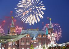Fireworks over the Christmas New Year holidays illumination and State Historical Museum inscription in Russian,Moscow, Russia. Fireworks over the Christmas New Royalty Free Stock Images