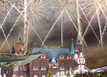 Fireworks over the Christmas New Year holidays illumination and State Historical Museum inscription in Russian,Moscow, Russia. Fireworks over the Christmas New Royalty Free Stock Photos