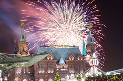 Fireworks over the Christmas New Year holidays illumination and State Historical Museum inscription in Russian,Moscow, Russia. Fireworks over the Christmas New Stock Photo