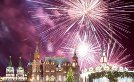 Fireworks over the Christmas New Year holidays illumination and State Historical Museum inscription in Russian,Moscow, Russia Royalty Free Stock Image