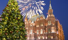 Fireworks over the Christmas New Year holidays illumination and State Historical Museum inscription in Russian,Moscow, Russia Stock Image